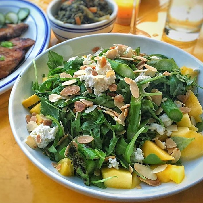 Dining Miss Lilys Restaurant Mango Arugula Toasted Almonds